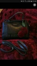 Black and grey leather handbag