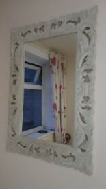 white wooden ornate mirror