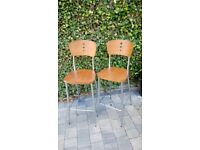Two teak and chrome bar/kitchen stools