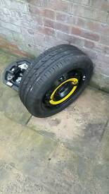 Spare wheel and new tyre