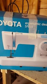 Toyota sewing machine, used once, brand new condition