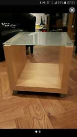 Two oak and glass tables