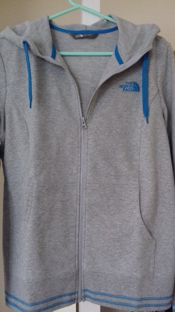 A brand new ladies' North Face hooded top ,size L in grey ,warm and nicely fitting