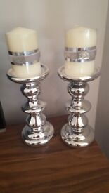 Pair of Lene Bjerre candles and silver candle sticks