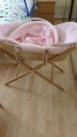Pink Moses basket by Mama and Papas with hood and wooden stabd, all in excellent condition