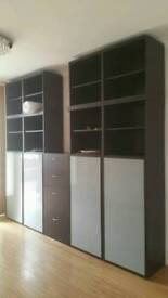 Black shelving unit with drawers dining room