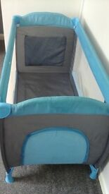 blue travel cot