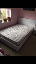 White leather look queen size bed with mattress nearly new very good condition