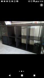 Black shelving unit with two drawers