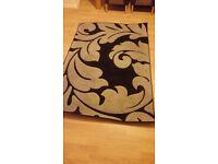Lovely Black rug. 170 x 117. Only £8