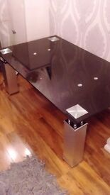 Glass coffee table , with chrome legs. Very good condition almost new. Black