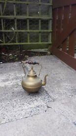 Old brass kettle and serving utensils