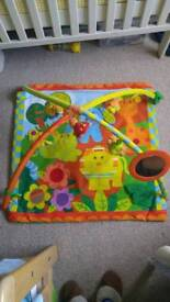 Baby playmat with a music box