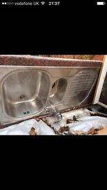 Stainless steel sink with GROHE tap.
