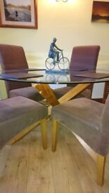 Glass top dining table and 4 chairs. . As new. . £300