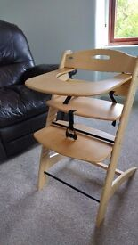 Wooden high chair converts to toddler chair