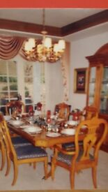 Beautiful dining room suite and crystal cabinet for sale.