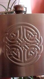Hip flask with celtic design