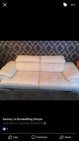 White leather sofa and cuddle chair