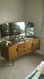 Dark wood dressing table.