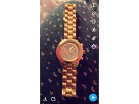 Women's gold Mk watch