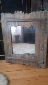 Driftwood style mirror. Stylish mirror with wall hanging fixture.