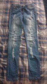 Ladies blue jeans size 8.