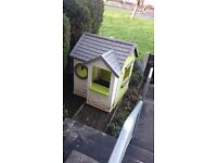 Outdoor childrens playhouse