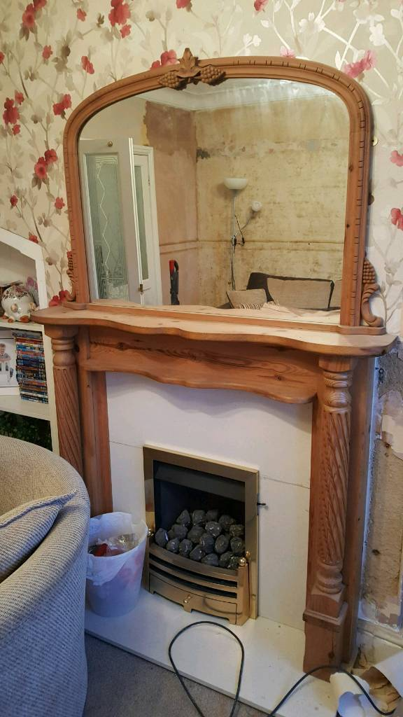 natural oak fire place and mirror