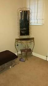 Wrought iron table and mirror.