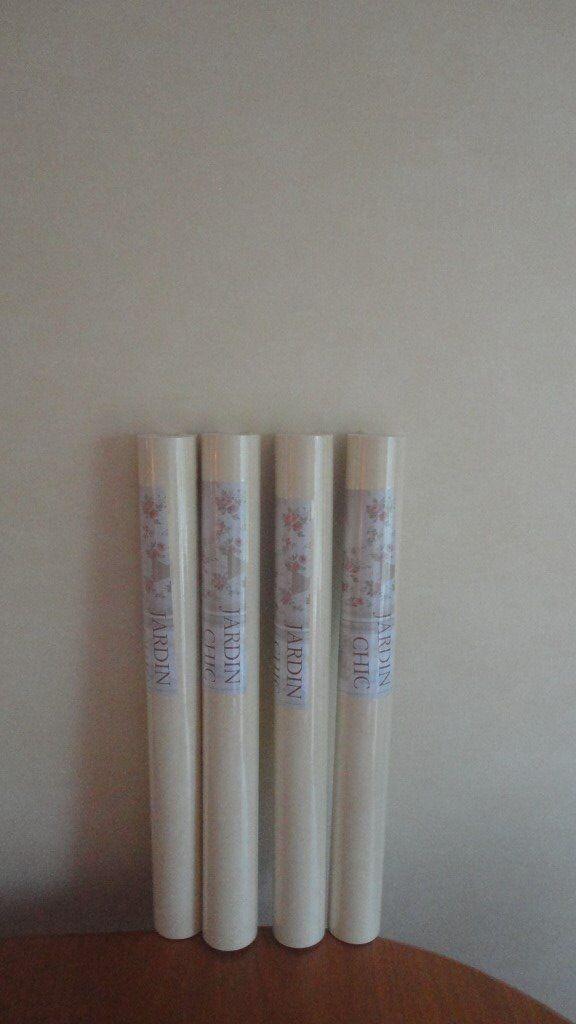 4 Unopened Rolls of Wallpaper