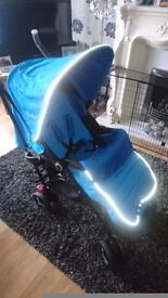 Silver cross reflex stroller blue. Includes raincover, Footmuff, liner. Chest and crotch pads