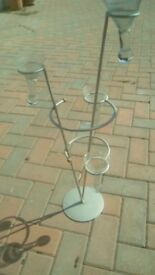 Tall metal stand with 4 glass vases.