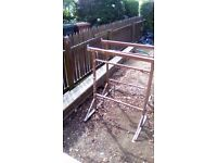 Lintels wheelbarrow and scaffolding and wooden planks