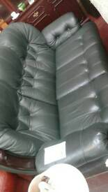 It's a dark green leather 3 seater sofa