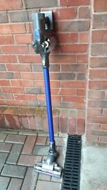 Dyson hand held vacuum cleaner complete with wall mount,charger and accessories