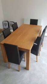 Solid oak dining table and 6 faux leather chairs