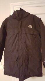 Northface Parker. Black in good condition. Age 14/16 (L/G). Small hole on sleeve.