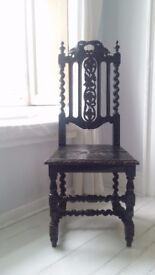 Beautiful antique black chair with stunning details