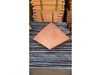 Rosemary arris hip roof tiles.