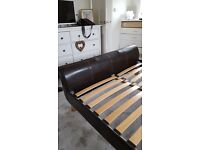 King size Bed. Brown faux leather. Sprung wooden slats. Excellent condition