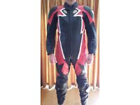 Motorcycle leathers, one piece in black, red & white, excellent condition, made by Frank Thomas