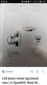 Designer basin mixer tap