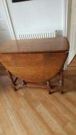 Small-ish Oval Mahogany Vintage Dining Table with 2 Leaves