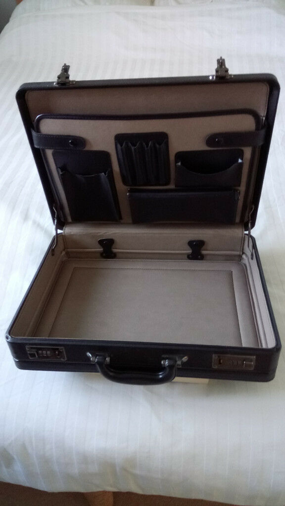 Brief case with combination lock