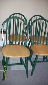 Solid wood dining table and 4 chairs.