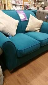 New 2 seater teal sofa.. we also have a matching 3 seat sofa bed in store