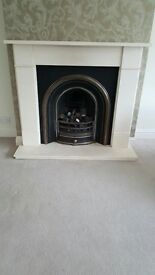 Stone fireplace surround and coal effect gas fire