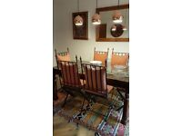 Glass topped dining table and 6 chairs with cushions