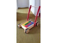 Toddler walker with coloured bricks with letters, numbers and symbols.